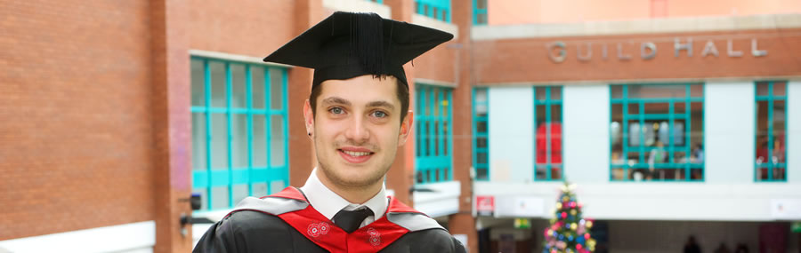 Student outside the preston guild hall with mortarboard receiving his masters degree